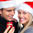 Royalty-Free Stock Photo: Christmas - young man giving woman a present