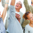 Education concept - Group of students celebrating success - Stock Photo