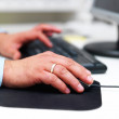 Royalty-Free Stock Photo: Married mans hand using computer mouse