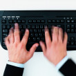 Royalty-Free Stock Photo: Top view of a mans hands in motion typing on keyboard