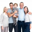 Portrait of a smiling happy family standing together - Stock Photo