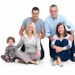 Portrait of a happy family sitting together isolated - Stock Photo