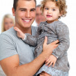 Royalty-Free Stock Photo: Proud young father holding his daughter in his arms