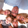 Royalty-Free Stock Photo: Closeup of a happy family in circle Isolated