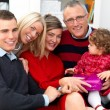 Festive family having a cosy christmas - Stock Photo