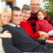Family portrait festive at christmas time - Stock Photo