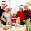Royalty-Free Stock Photo: Festice family sitting at home at christmas time