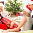 Festive family laughing and opeing christmas gifts - Stock Photo