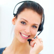 Closeup of a happy young woman wearing headphones - Stock Photo