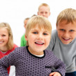 Confident young children smiling happily - Stock Photo