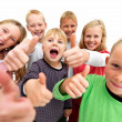 Children giving thumbs up sign - Stock Photo