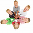 Royalty-Free Stock Photo: Circle of children holding hands showing togetherness