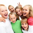 Group of excited young children laughing - Stock Photo