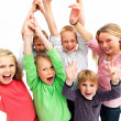 Successful young children raising their hands - Stock Photo