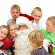 Closeup of  Santa Claus with children isolated - Stock Photo