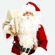 Closeup of Santa Claus with Present bag - Stock Photo