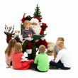 Santa Claus Reading his list with kids isolated - Stock Photo