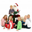 Royalty-Free Stock Photo: Santa Claus and children looking at you