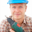 Handyman holding a drill ready to fix - Stock Photo