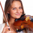 Pretty young woman playing her violin - Stock Photo