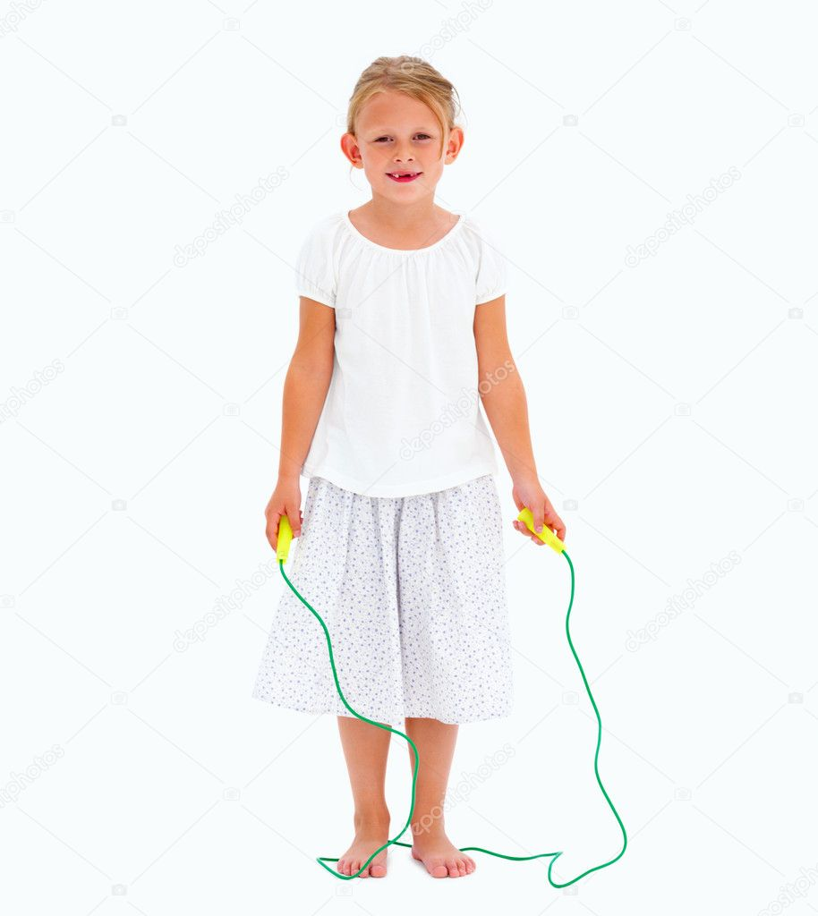 Portrait of a cute young girl holding skipping rope,On White  Stock Photo #3270472