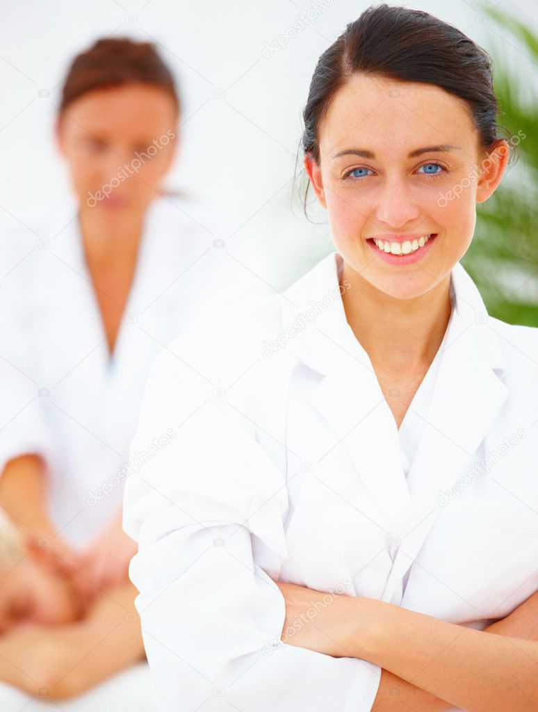 Smiling pretty female therapist standing at spa  Stock Photo #3271316
