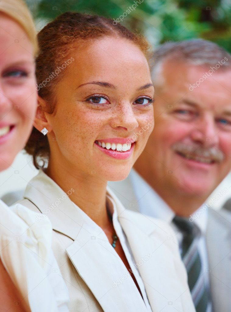 Young businesswoman standing between colleagues — Stock Photo #3272286