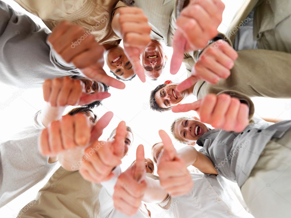 Laughing business colleagues showing thumb's up sign — Stock Photo #3275557