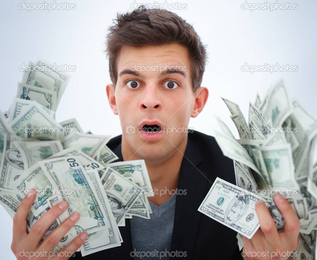 Portrait of a surprised young business man holding money  — Stock Photo #3277360