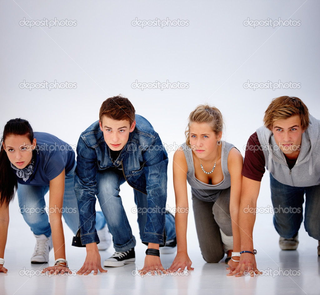 Young teens on the start position ready to run — Stock Photo #3277426