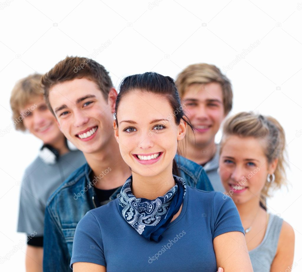 Closeup of young smiling friends standing in a row with woman in front — Stock Photo #3277539