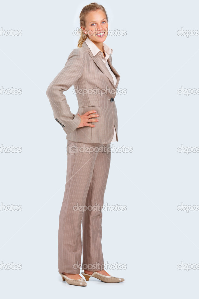 Full length portrait of a young business woman with hands on waist isolated on white background — Stock Photo #3278133