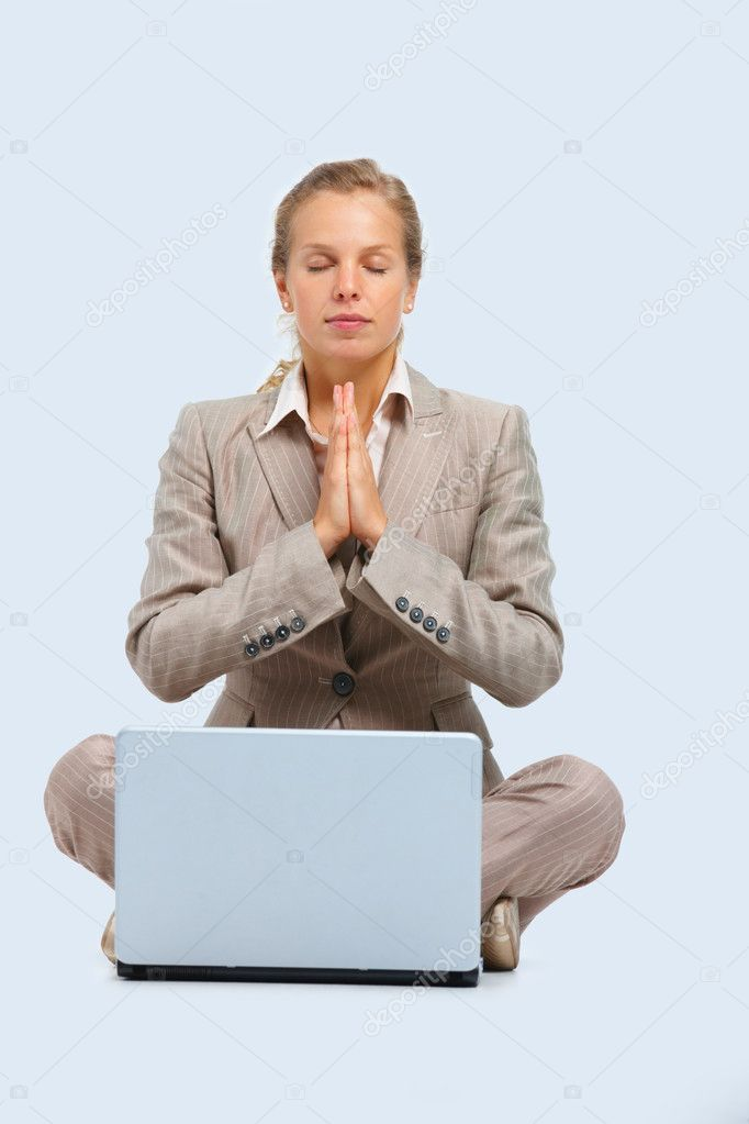 Full length portrait of a young business woman praying with a laptop isolated on white background — Stok fotoğraf #3278186
