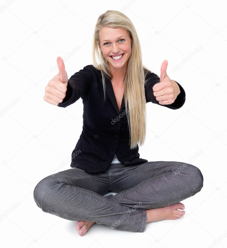 Portrait of a happy young woman showing thumbs up sign on white background — Stock Photo #3278502