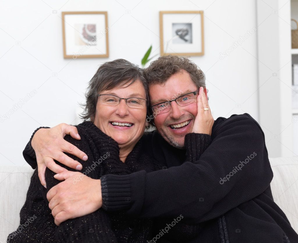 depositphotos 3278514 Happy mature couple with arms around each other Old couple working together on computer stock photo, Senior man and woman ...