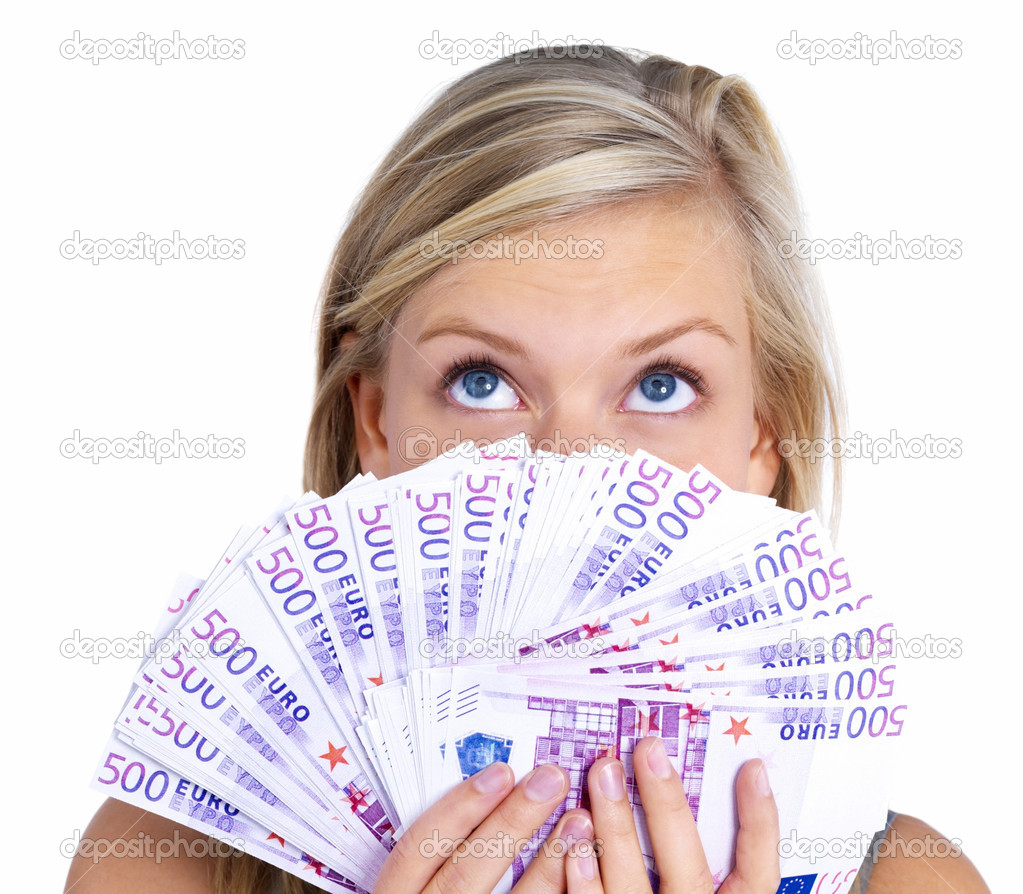 Closeup portrait of a woman holding cash on face and looking up isolated on white background — Stock Photo #3278636