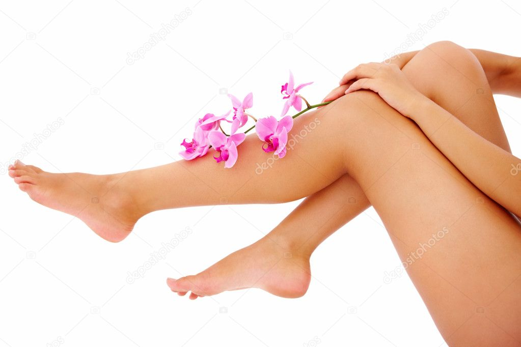 Beautiful portrait of a young woman's legs with flowers in hand  Stock Photo #3278703