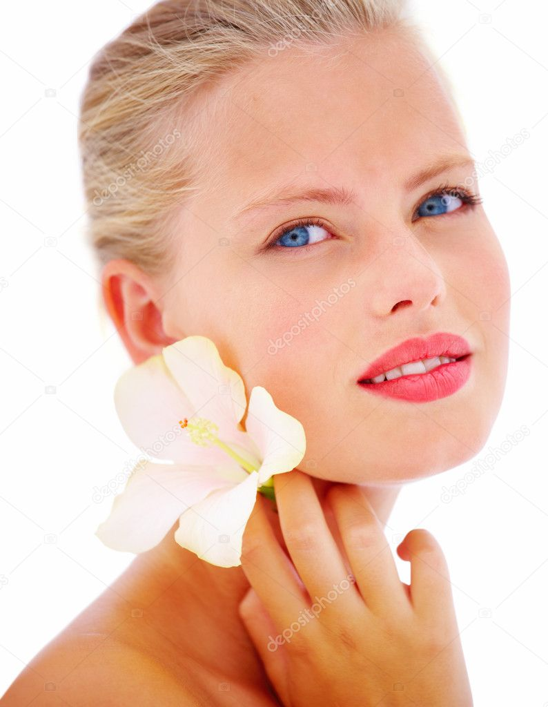 Closeup portrait of a young beautiful woman with flower isolated on white background  Stock Photo #3278715