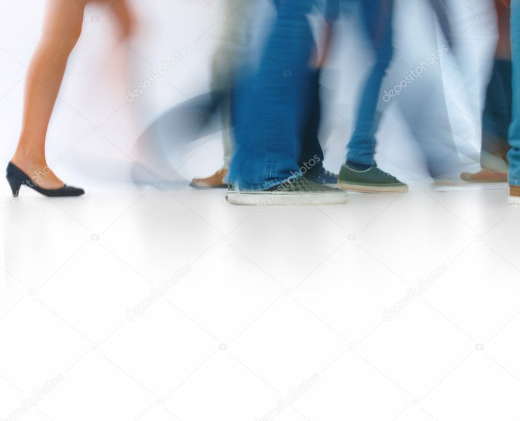 Closeup portrait of young men and women walking isolated on white background — Stock Photo #3278797