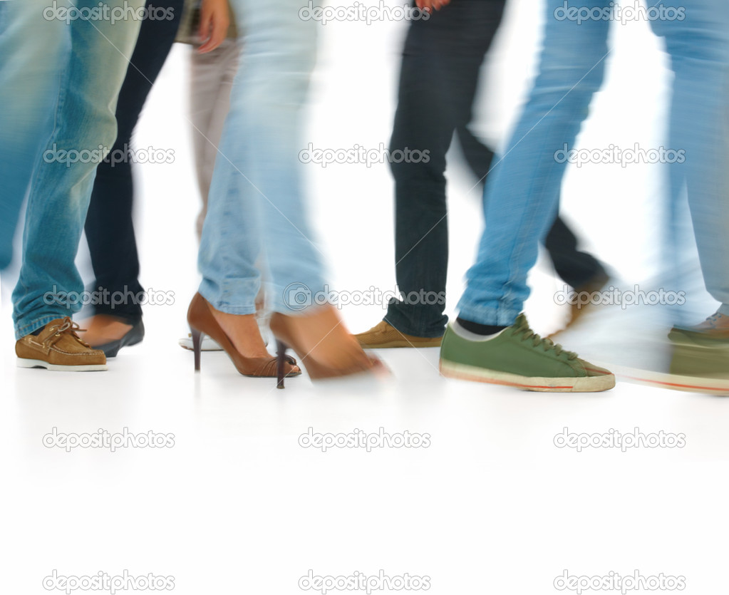 Closeup portrait of young men and women walking isolated on white background — Stok fotoğraf #3278800