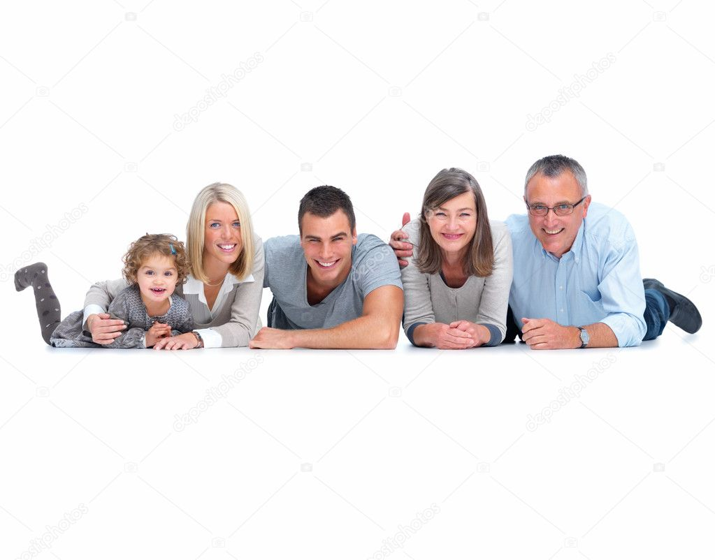 Full portrait of a happy family lying on the floor isolated on white background — Stock Photo #3279009