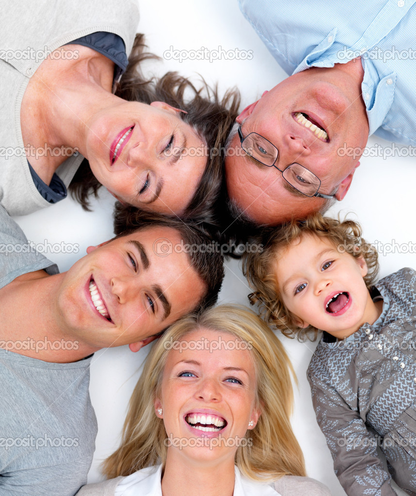 Closeup portrait of a happy family lying in a circle on white floor — Stock Photo #3279127