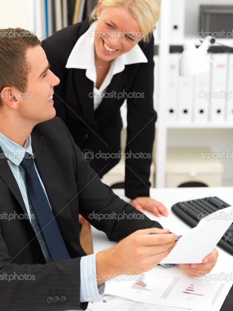Closeup portrait of businessman and a woman smiling with a bookshelf in background — Stock Photo #3279206