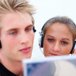 Royalty-Free Stock Photo: Young couple checking out a new music cd
