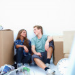 Couple taking a break from moving house - Stock Photo