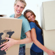 Royalty-Free Stock Photo: Happy couple carrying boxes moving house