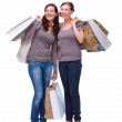 Royalty-Free Stock Photo: Isolate of young happy shoppers carrying shopping