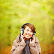 Young woman enjoying listening to music - Stock Photo