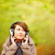 Woman listening to music outside in Autumn