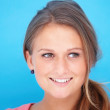 Royalty-Free Stock Photo: Portrait of a smiling young woman copyspace